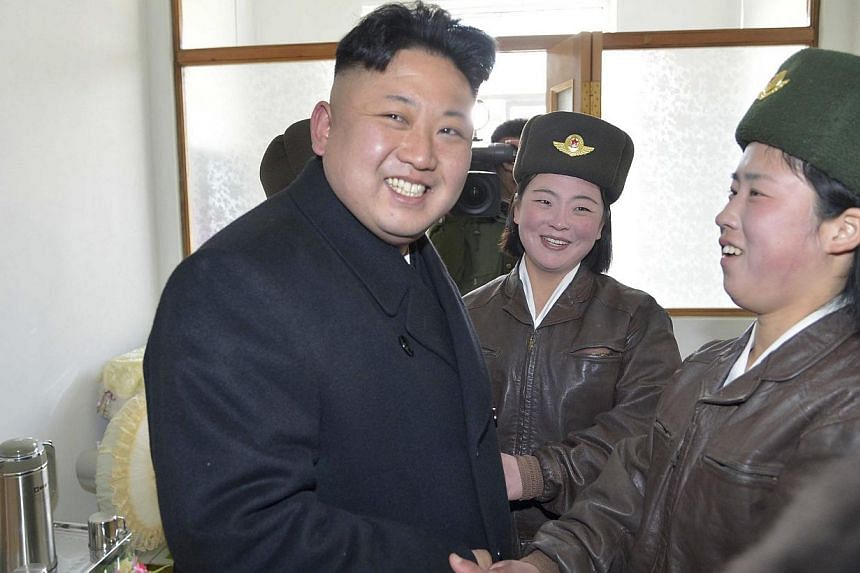 North Korean leader Kim Jong Un supervising a flight drill of the KPA Air and Anti-Air Force Unit 2620 in this undated photo released by North Korea's Korean Central News Agency on March 7, 2014. -- FILE PHOTO: REUTERS