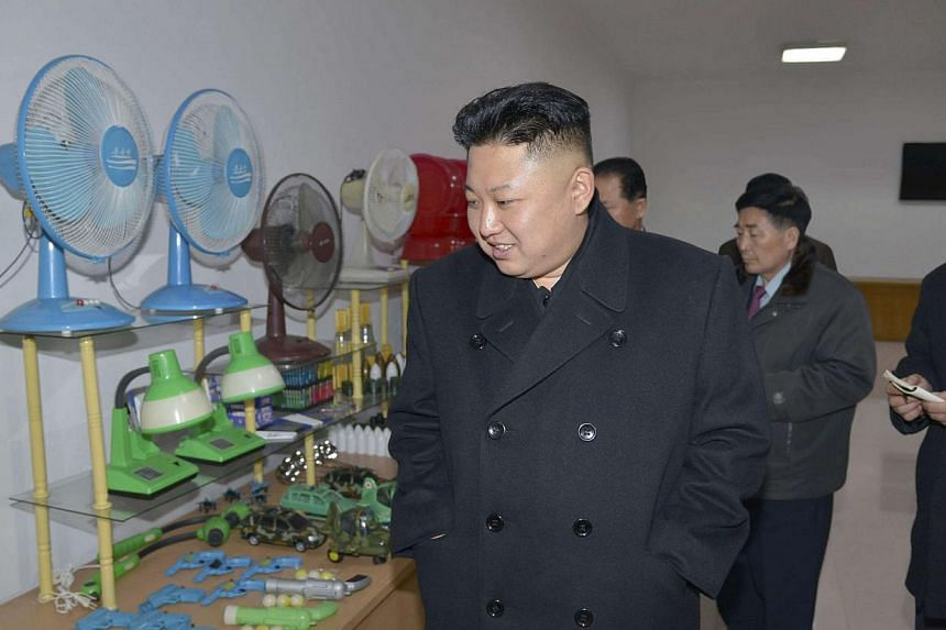 North Korean leader Kim Jong Un (front) on a trip to the Pyongyang Weak-current Apparatus Factory in this undated photo released by North Korea's Korean Central News Agency in Pyongyang on March 3, 2014. -- FILE PHOTO: REUTERS