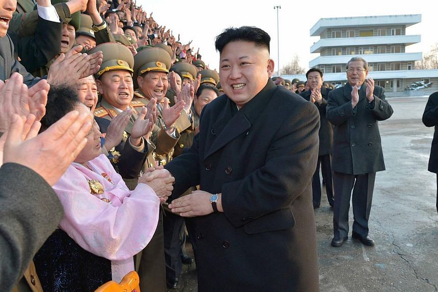 North Korean leader Kim Jong Un visiting participants of a national agriculture competition in this undated photo released by North Korea's Korean Central News Agency on Feb 10, 2014. -- FILE PHOTO: REUTERS