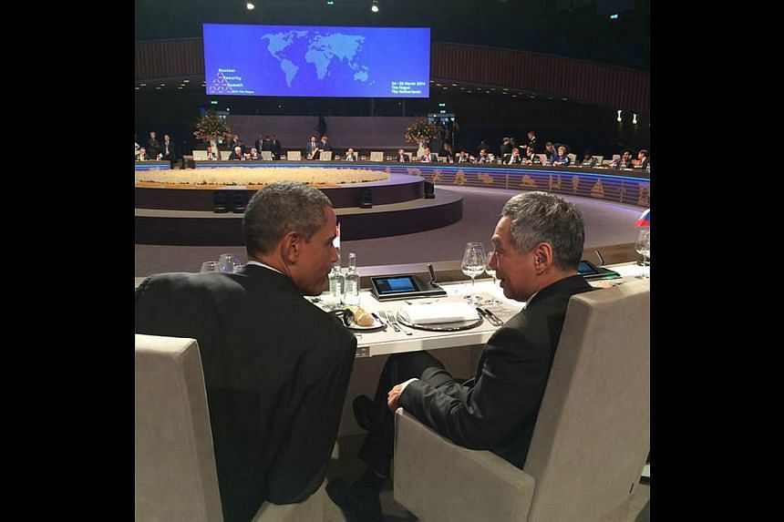 US President Barack Obama and PM Lee at the Nuclear Security Summit on Tuesday. Mr Lee said valuable steps had been taken to secure nuclear materials in the past four years. -- PHOTO: FACEBOOK PAGE OF LEE HSIEN LOONG