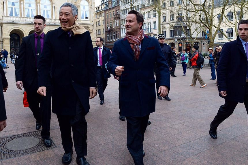 PM Lee Hsien Loong walking along a street in Luxembourg with his counterpart, Mr Xavier Bettel, yesterday. Mr Bettel hosted lunch for Mr Lee after a bilateral meeting and a joint press conference. The two leaders said they had excellent discussions a