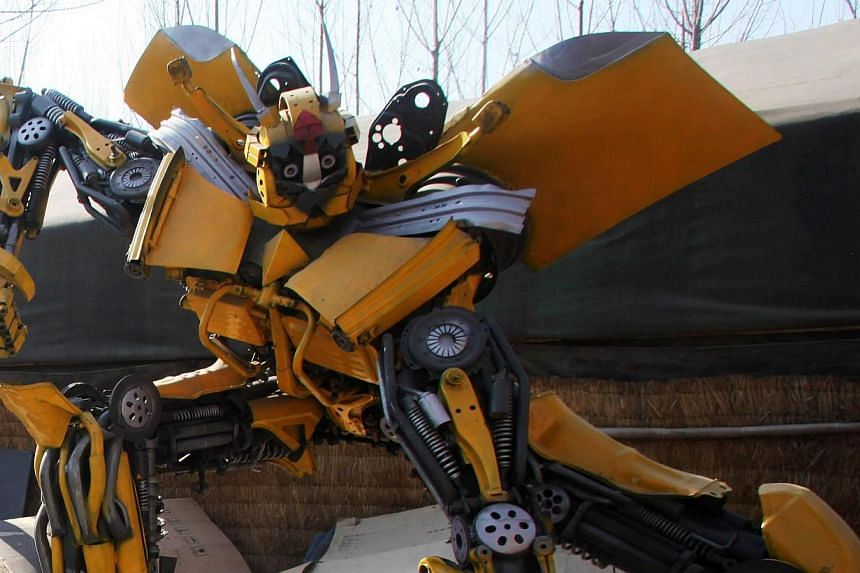 """A life-sized """"Transformer"""" model in a yard in Jinan, east China's Shandong province on March 21, 2014.-- FILE PHOTO: AFP"""