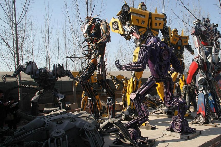 A group of life-sized Transformer models on display in a yard in Jinan, east China's Shandong province on March 21, 2014. -- FILE PHOTO: AFP