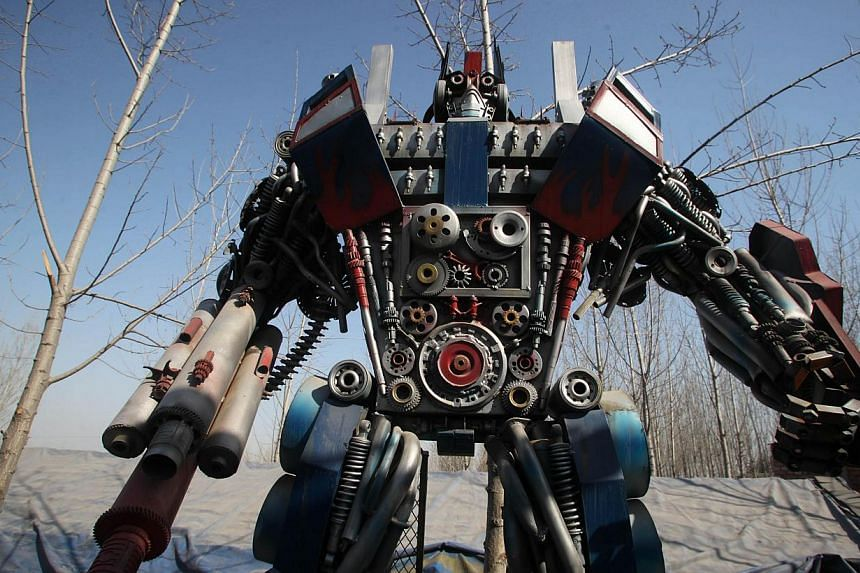 A life-sized Transformer model on display in a yard in Jinan, east China's Shandong province on March 21, 2014. -- FILE PHOTO: AFP