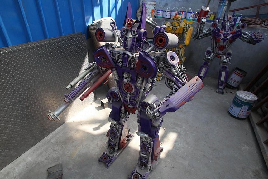 Several life-sized Transformer models on display in a yard in Jinan, east China's Shandong province on March 21, 2014. -- FILE PHOTO: AFP