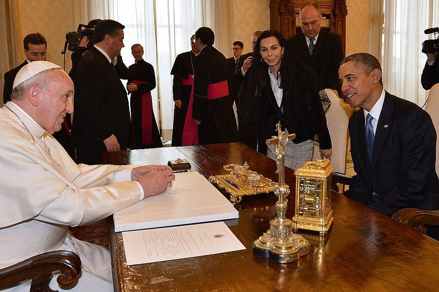 Pope Francis (left) meets with US President Barack Obama on March 27, 2014 at the Vatican. President Obama met with Pope Francis for the first time on Thursday for talks expected to focus on efforts to combat global inequality. -- PHOTO: AFP