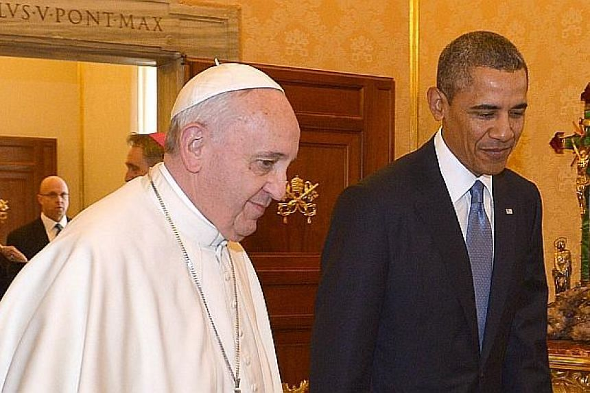 Pope Francis (left) meets with US President Barack Obama on March 27, 2014 at the Vatican. -- PHOTO: AFP