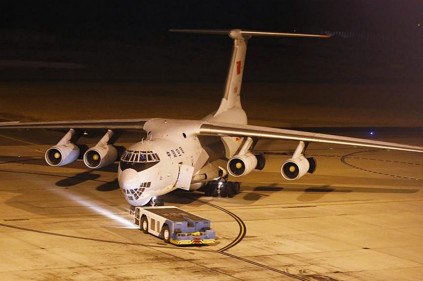One of two Chinese Air Force Ilyushin Il-76 aircraft being used in the search for Malaysian Airlines flight MH370, is towed on the tarmac of Perth International Airport, on March 25, 2014. China will intensify search efforts for missing Malaysia Airl
