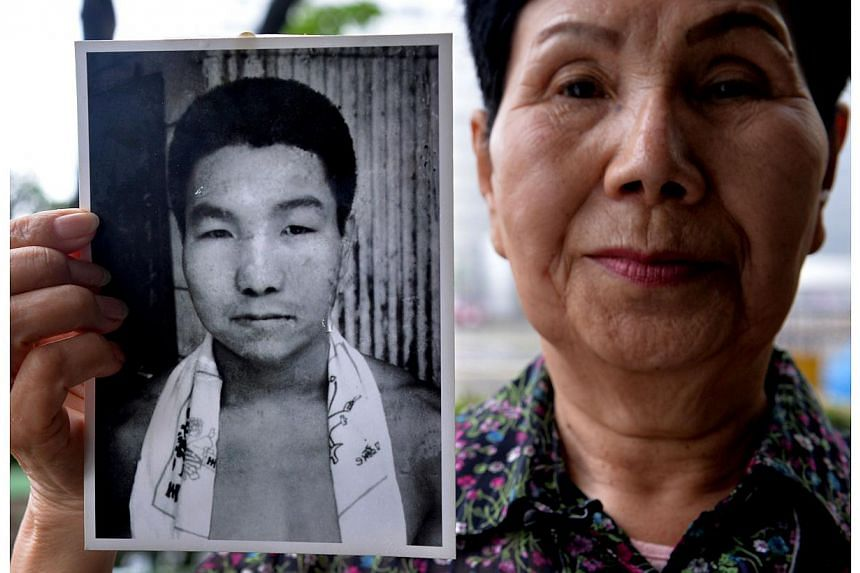 Hideko Hakamada, sister of former boxer Iwao Hakamada who has been on death row in Japan for 48 years, holding a picture of her young brother Iwao during an interview outside the Tokyo Detention House in Tokyo, on May 20, 2014.A man believed to