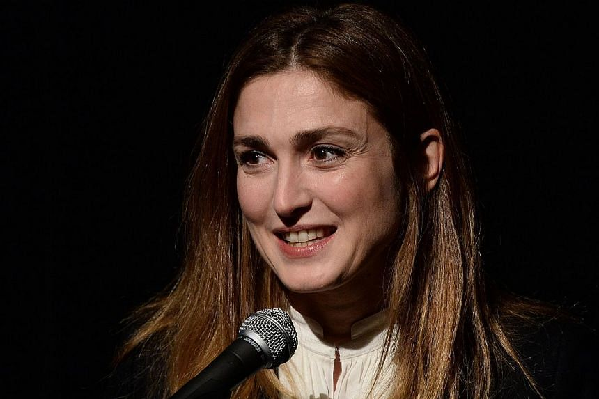 A French court on Thursday, March 27, 2014, ordered Closer magazine to pay actress Julie Gayet 15,000 euros (S$26,218) over breach of privacy after it revealed her affair with President Francois Hollande in January. -- PHOTO: AFP