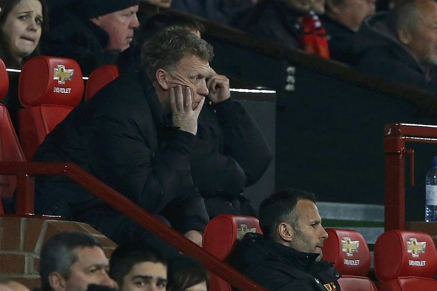 Manchester United manager David Moyes found himself beneath an increasingly intense spotlight on Wednesday, March 26, 2014, amid press reports of fan dissent in the wake of his side's defeat by Manchester City. -- FILE PHOTO: REUTERS