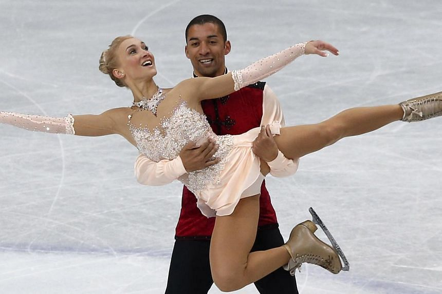 Germany's Aliona Savchenko and Robin Szolkowy compete during the pairs free skating program at the ISU World Figure Skating Championships in Saitama, north of Tokyo, on March 27, 2014. Germany's double Olympic figure skating bronze medallists Aliona