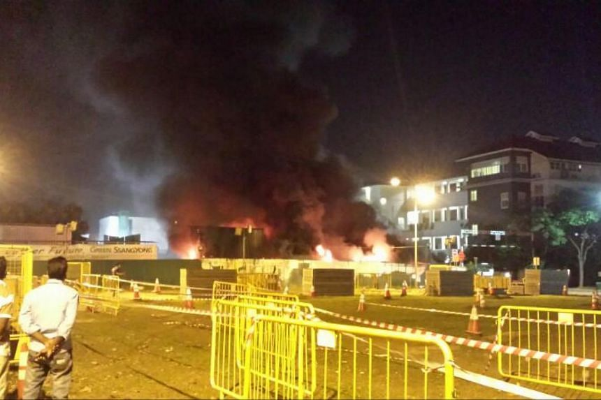 A fire broke out on Thursday night along Race Course Road at a worksite where the Little India station of the Downtown Line 2 is being constructed.-- ST PHOTO: RAVI VELLOOR
