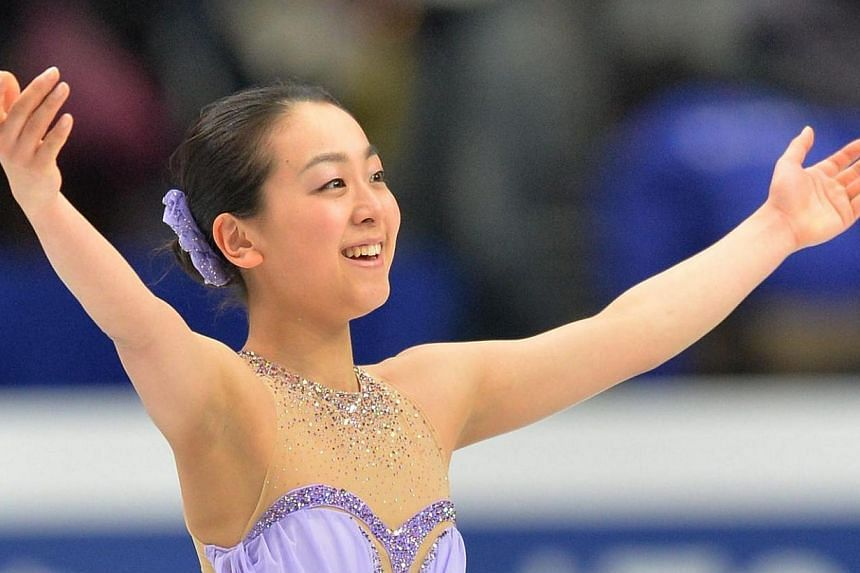 Japan's Mao Asada reacts after her performance in the ladies' short program at the world figure skating championships in Saitama on Thursday, March 27, 2014. Japan's Mao Asada broke the short programme world record in a bid for a third women's t