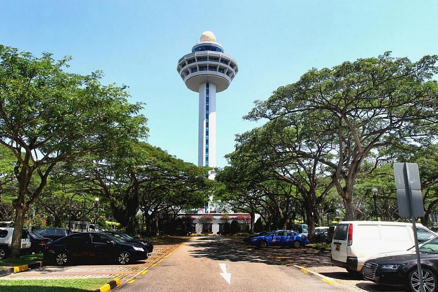 The control tower is seen from the open-air carpark of Terminal One of Changi Airport.Changi Airport has been named the world's best airport in a global survey of travellers. -- ST FILE PHOTO:CHEW SENG KIM