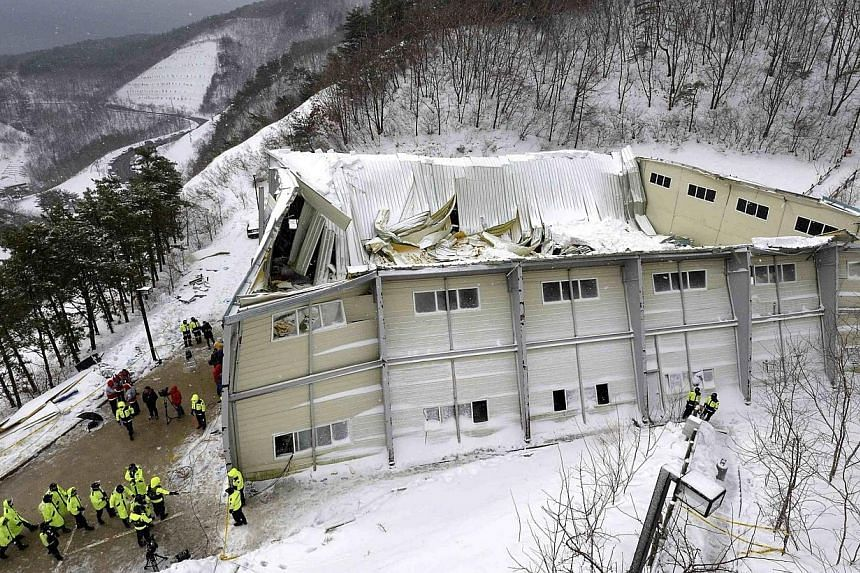 A collapsed resort building is seen in Gyeongju, about 375 km (235 miles) southeast of Seoul on Feb 18, 2014. South Korean police on Thursday, March 27, 2014, named 22 people who may face criminal charges over the collapse last month of a gymnas
