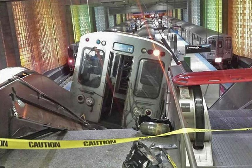 A derailed commuter train resting on an escalator at O'Hare international airport in Chicago on March 24, 2014. -- FILE PHOTO: REUTERS/NBC CHICAGO