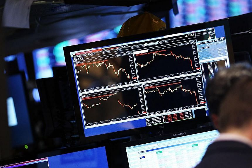 United States (US) stocks fell on March 26, 2014, led by losses in the technology and materials sectors, as geopolitical concerns rose after the US and the European Union (EU) agreed to work together on tougher sanctions on Russia. -- FILE PHOTO: AFP