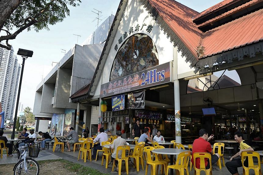 Hawkers at Lavender Food Square (above and left) will be moving out soon as the food centre and Eminent Plaza (far left) nearby are going to be redeveloped. Diners said they will miss the food centre's veritable feast at affordable prices.