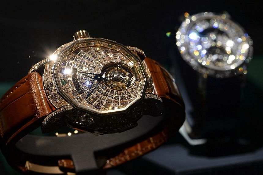 """A """"MasterGraff Ultraslim Tourbillon"""" by British jeweller and watchmaker Graff at the BaselWorld watch fair on March 26, 2014. Graff also unveiled a glittering wristwatch, called """"Hallucination"""", set with a multitude of rare coloured diamonds. -- PHOT"""