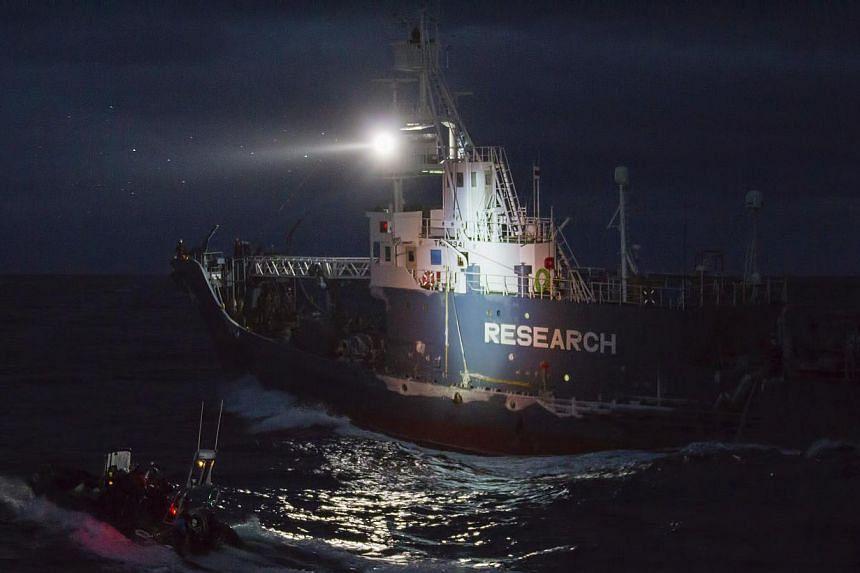 A small boat launched from the Sea Shepherd vessel The Bob Barker manoeuvres alongside the Japanese whaling vessel Yushin Maru 3 on Feb 23, 2014. -- FILE PHOTO: REUTERS/SEA SHEPHERD AUSTRALIA