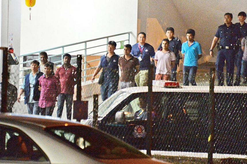 Police have arrested 35 foreign workers who were involved in the fight at Homestay Residences at Kaki Bukit Avenue 3 on 25 March 2014. -- FILE PHOTO: SHIN MIN