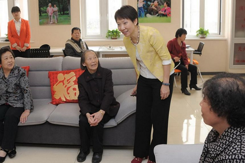 Singapore's Minister Grace Fumet elderly Chinese residents who were enjoying the facilities at the Neighbourhood Centre in the Tianjin Eco-City. The Neighbourhood Centre was developed with reference to neighbourhood centres in Singapore. -- PHO