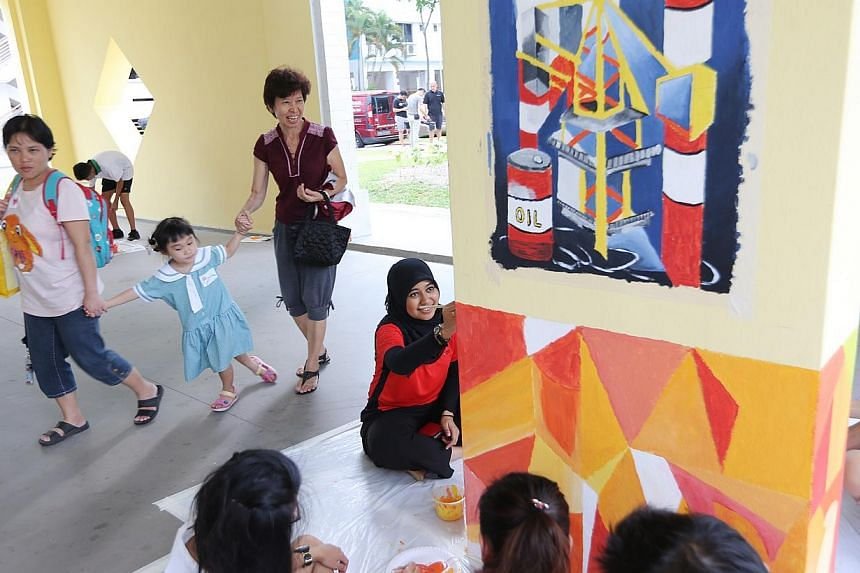 DBS staff led by CEO Piyush Gupta jointly painted the bare void decks of Gek Poh, one of Singapore's oldest districts, with around 100 residents and students from the neighbouring secondary schools. -- ST PHOTO:ONG WEE JIN