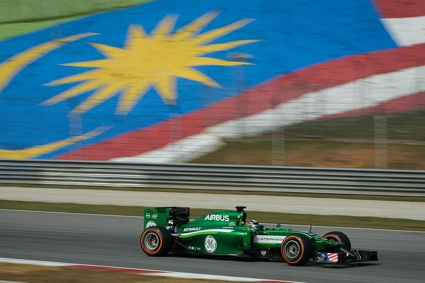 Caterham driver Kamui Kobayashi of Japan takes part in the first practice session of the Formula One Malaysian Grand Prix at the Sepang circuit near Kuala Lumpur on March 28, 2014. -- PHOTO: AFP