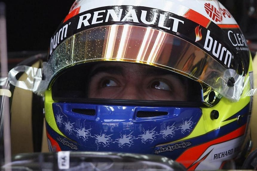 Lotus Formula One driver Pastor Maldonado of Venezuela waits in his car during the first practice session of the Malaysian F1 Grand Prix at Sepang International Circuit outside Kuala Lumpur March 28, 2014. -- PHOTO: REUTERS