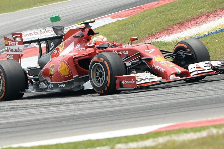 Ferrari driver Kimi Raikkonen of Finland speeds up around a corner during the second practice session at Formula One Malaysian Grand Prix in Sepang on March 28, 2014. -- PHOTO: AFP