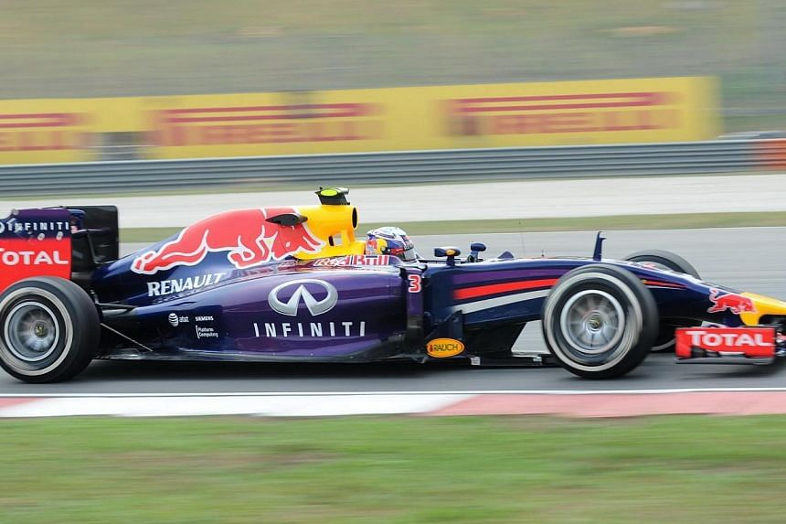 Red Bull driver Daniel Ricciardo of Australia speeds up during the second practice session at Formula One Malaysian Grand Prix in Sepang on March 28, 2014. -- PHOTO: AFP