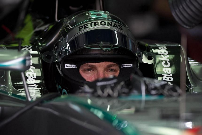 Mercedes driver Nico Rosberg of Germany looks on during the second practice session ahead of the Formula One Malaysian Grand Prix in Sepang, outside Kuala Lumpur on March 28, 2014. -- PHOTO: AFP