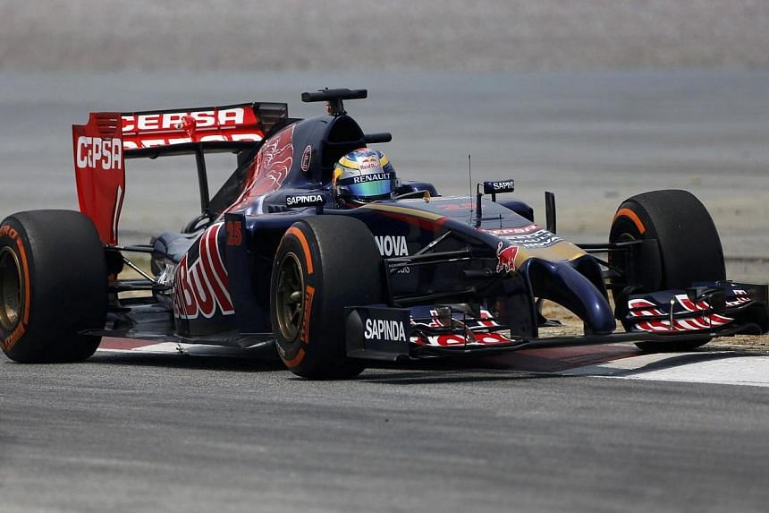 Toro Rosso Formula One driver Jean-Eric Vergne of France drives during the second practice session of the Malaysian F1 Grand Prix at Sepang International Circuit outside Kuala Lumpur on March 28, 2014. -- PHOTO: REUTERS