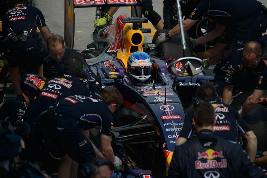 Red Bull driver Sebastian Vettel of Germany enters the pit during the second practice session of the Formula One Malaysian Grand Prix at the Sepang circuit near Kuala Lumpur on March 28, 2014. -- PHOTO: AFP