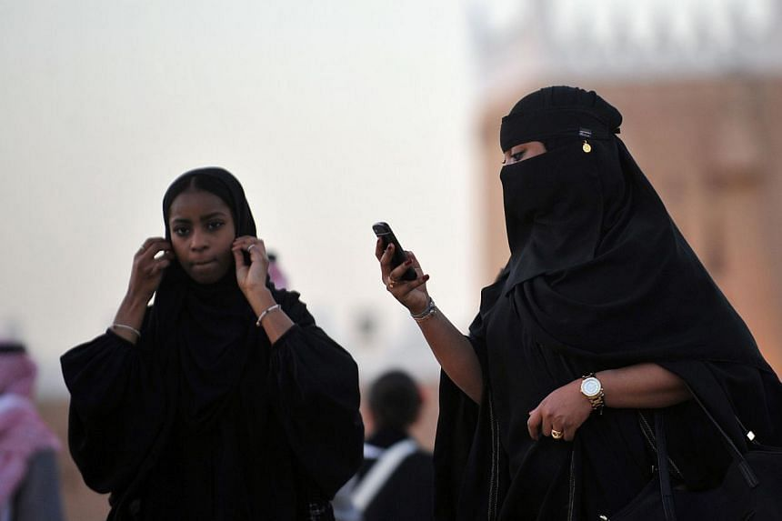 Saudi women arrive at the Janadriyah festival of Heritage and Culture held in the village of Al-Thamama, 50km north of the capital Riyadh. Saudi activists have urged women to defy a traditional driving ban and get behind the wheel on Saturday, the se