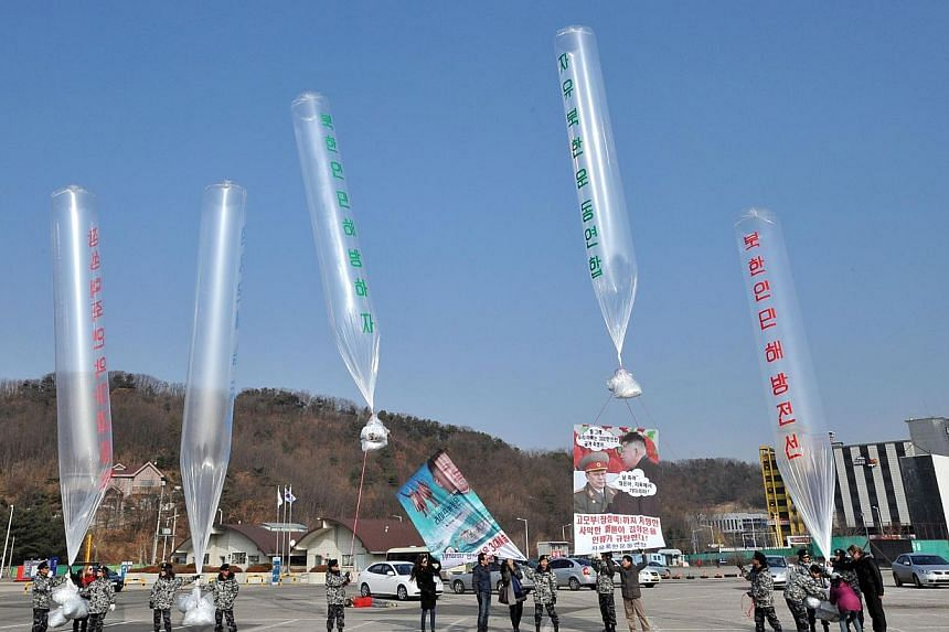 Former North Korean defectors and US human rights activists release balloons carrying anti-North Korea leaflets at a park in the border town of Paju, north of Seoul, on Jan 15, 2014. North Korea said on Saturday its relations with South Korea had bee