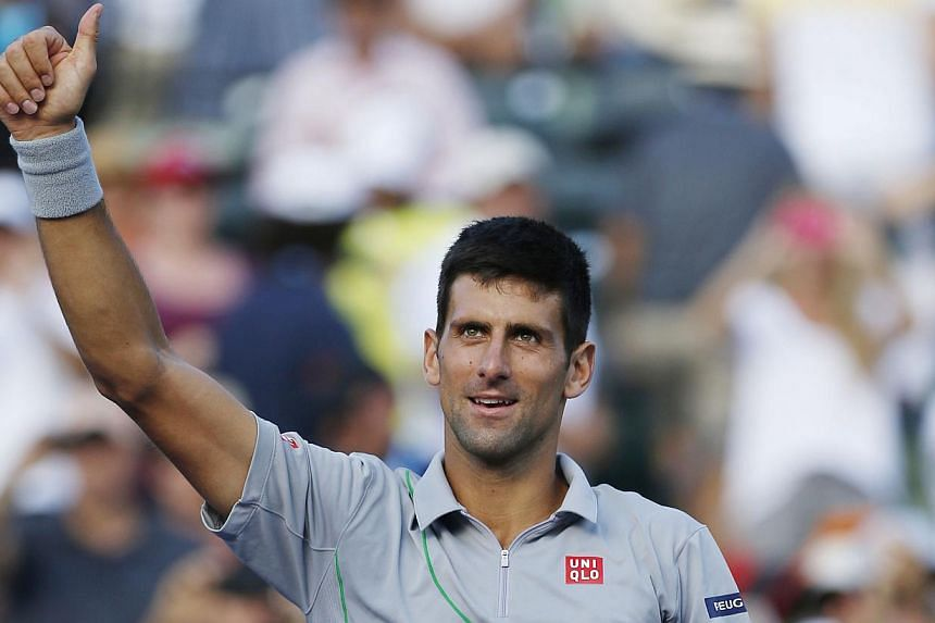 On March 26, 2014; Miami, FL, USA; Novak Djokovic waves to the crowd after his match against Andy Murray (not pictured) on day ten of the Sony Open at Crandon Tennis Center. -- FILE PHOTO: REUTERS