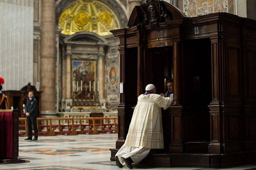Pope Francis confesses himself during a Penitential Liturgy ceremony in St. Peter's Basilica at the Vatican on March 28, 2014. -- PHOTO: REUTERS