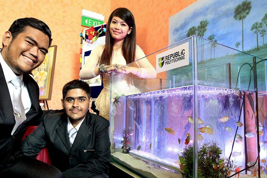 Republic Polytechnic students (from left) Hazman Azri and Pranav Gour, 18, with Ms Sin Sopheana of the Royal University of Phnom Penh, are working on a project to grow the freshwater gourami fish in padi fields.