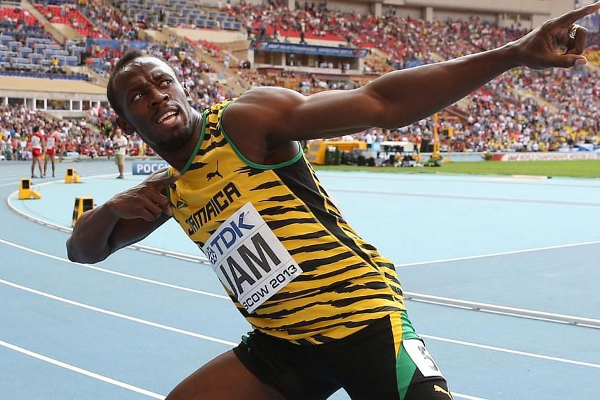 Jamaica's Usain Bolt celebrates after winning the men's 4x100m relay final at the 2013 IAAF World Championships in Moscow on August 18, 2013.Bolt, who has suffered a foot injury, will not race again until mid-June, his agent confirmed to AFP. -