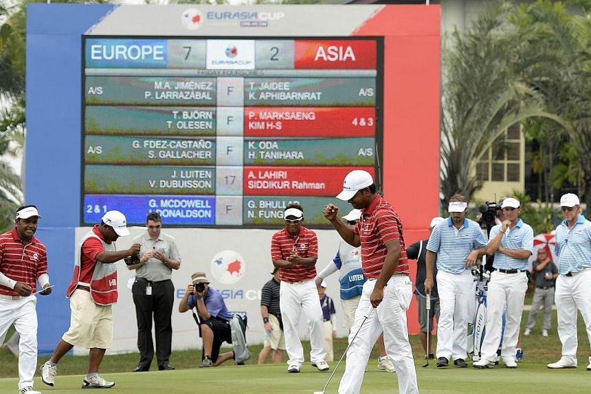 This handout photo taken and released on March 28, 2014, shows team Asia Anirban Lahiri of India celebrating during the EurAsia Cup in Glenamarie Golf and Country Club in Kuala Lumpur. -- PHOTO: AFP