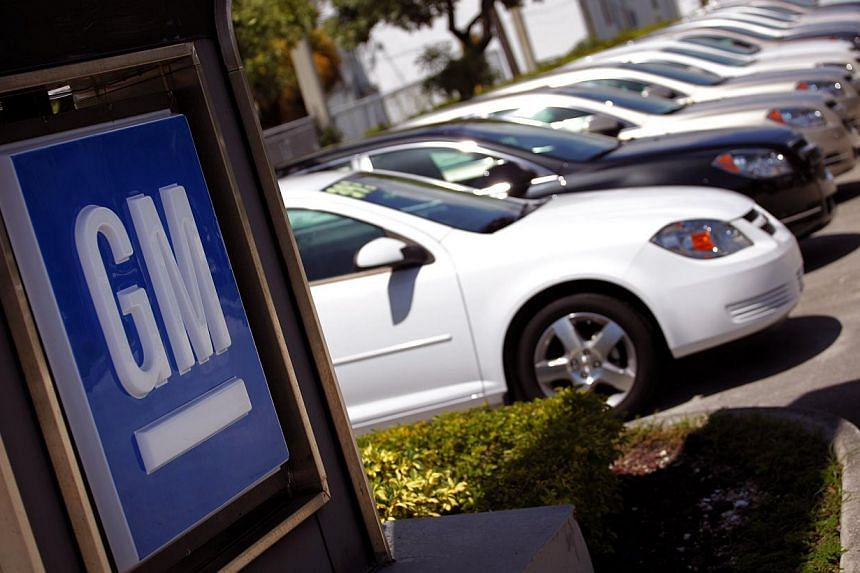 Chevrolet cars are seen at a General Motors (GM) Co dealership in Miami, Florida on Aug 12, 2010. GM is adding 971,000 cars to its ignition switch recall, which began in February with 1.6 million vehicles and has been linked to a dozen deaths. -- FIL