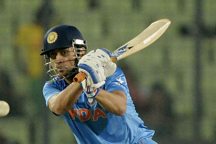 Indian captain Mahendra Singh Dhoni plays a shot during the ICC World Twenty20 tournament Group 2 cricket match between India and Bangladesh at The Sher-e-Bangla National Cricket Stadium in Dhaka, on March 28, 2014. For the second time in less than a