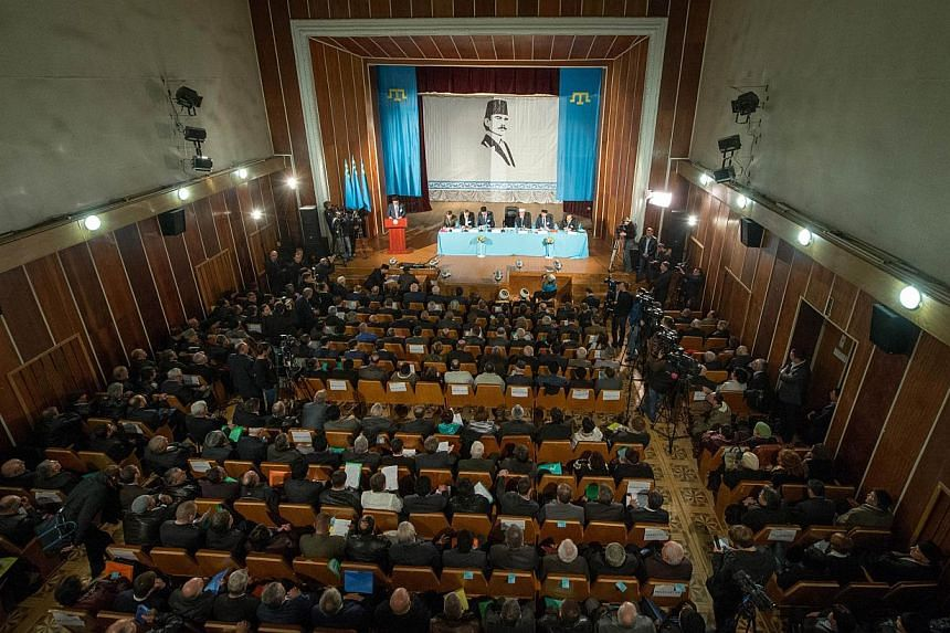 Muslim Tatars attend the Crimean Tatar Qurultai, or congress, in Bakhchisaray, on March 29, 2014. Crimea's Tatars will on Saturday hold a vote on whether to push for self-rule in their historic homeland following its annexation by Russia.-- PHO