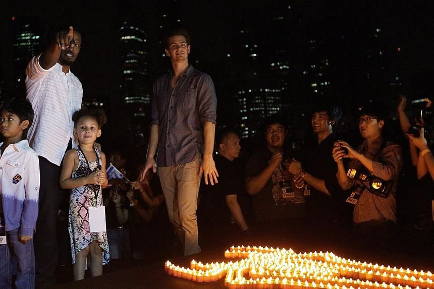 Singapore's celebration of the Earth Hour 2014 - the world's biggest social movement to protect the planet, held at The Float@Marina Bay, on March 29, 2014, as members of the public join Spider-Man (Earth Hour Superhero Ambassador), Andrew Garfie