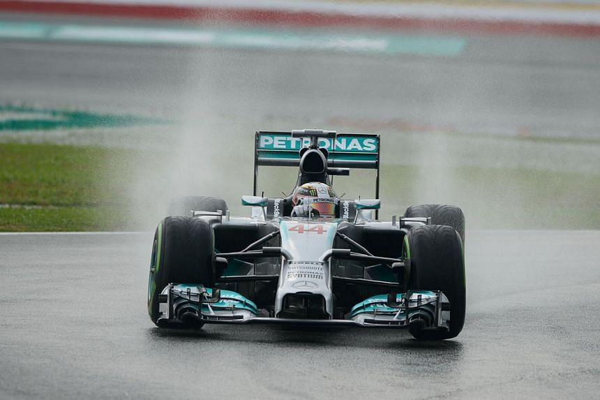 Mercedes driver Lewis Hamilton of Britain takes a corner during the first qualifying session of the Formula One Malaysian Grand Prix at the Sepang circuit near Kuala Lumpur, on March 29, 2014. Former Formula One world champion Lewis Hamilton avo