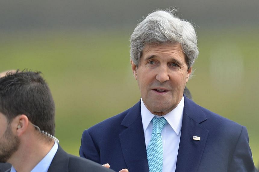 US Secretary of State John Kerry made a last-minute change of plans on Saturday, March 29, 2014, to fly to Paris with the aim of setting up talks with his Russian counterpart on the Ukraine crisis. -- PHOTO: AFP