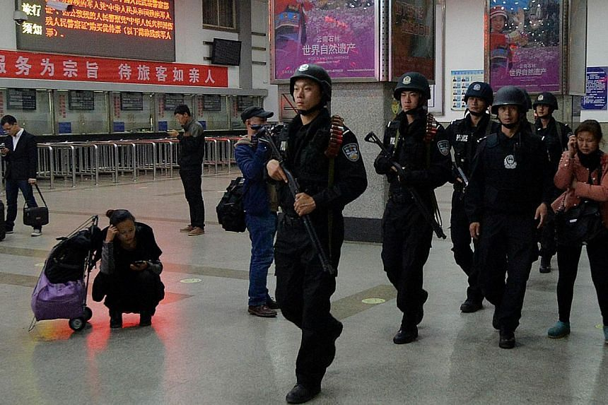 Chinese armed police patrol the scene of the terror attack at the main train station in Kunming, Yunnan Province, on March 2, 2014. China has laid out the charges against the four surviving suspects in a knife attack in the south-western city of Kunm