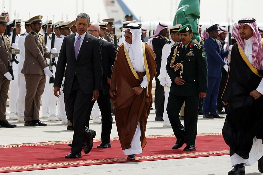 US President Barack Obama (front left) is escorted from Marine One to Air Force One as he departs Saudi Arabia to return to Washington, on March 29, 2014. President Obama flew home from Saudi Arabia on Saturday under fire for not doing more to raise